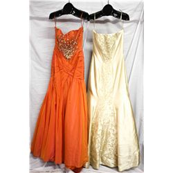 Description Change:Lot [2] DRESSES:  [1] YSA Makino orange evening gown, size 10 and [1] Gold