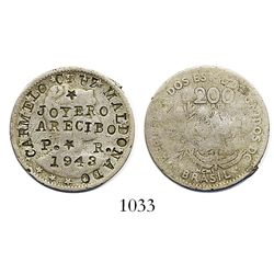 Arecibo, Puerto Rico, copper-nickel merchant token (Carmelo Cruz Maldonado) struck over a Brazil 200