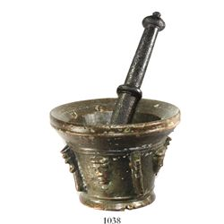 Bronze mortar and pestle set, faces and fins design.