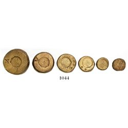 Set of six bronze coin weights (disks).