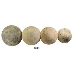 Lot of four small, stone cannonballs.