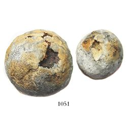 Lot of two small, lead-sheathed iron cannonballs.
