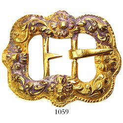 Ornate gold buckle with encrustation.