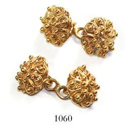 Pair of gold cagework cufflinks.