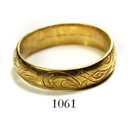 Gold wedding ring engraved with birds and flowers.