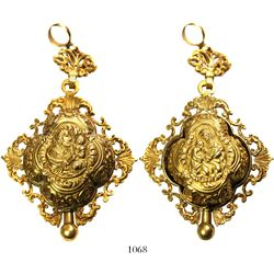 Large gold reliquary pendant with ornate border and hanger.