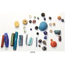Lot of 40 glass colored beads and carved piece, including some very rare color and shape combination