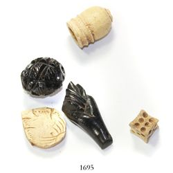 "Lot of 5 carved pieces in bone and jet, including a die and an ""higa,"" Spanish colonial (1500s-1600s"
