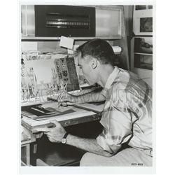 Collection of (3) photos featuring animation artists at work