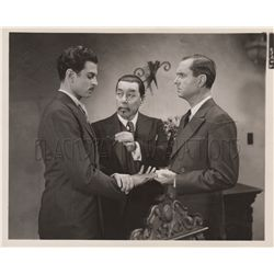 Warner Oland pair of (2) original still photos from Charlie Chan in Paris and Charlie Chan's Secret