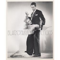 Collection of (4) film noir original stills from Framed featuring Glenn Ford