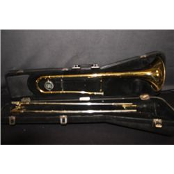 KING TROMBONE WITH ORIGINAL CASE AND MINOR DENTS -