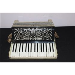 MIDSIZE ACCORDION BY WUDLITZER - VERY ORNATE WITH
