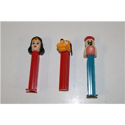 3 VINTAGE PEZ DISPENSERS INCLUDING: WONDERWOMAN, GOOFY (WITH MOVEABLE EARS) AND DROOPY