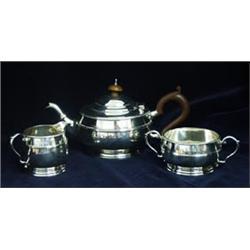 A THREE PIECE BATCHELOR TEA SET: tea pot, two handled sugar bowl and  cream jug, the edge beaded,