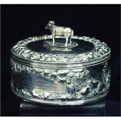 AN EARLY VICTORIAN CIRCULAR CASKET: the cover with embossed acorn and  oak leaf border, and ram h
