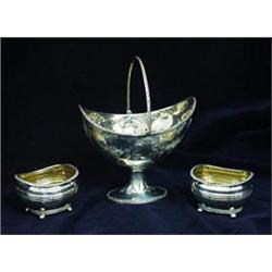 A VICTORIAN FOLIATE EMBOSSED BOAT SHAPED SUGAR BOWL: with beaded rim  and swing handle, raised an