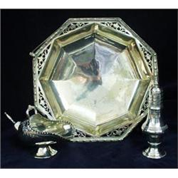 AN EDWARDIAN EPNS OCTAGONAL BREAD BASKET: beaded and pierced to  border with swing handle, raised