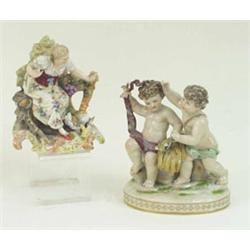 A LATE 19TH CENTURY CONTINENTAL PORCELAIN SEATED FIGURINE: with hen  and chicks, on rococo base,