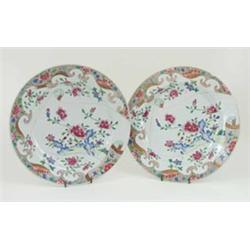 A PAIR OF 18TH CENTURY CANTONESE PLATES: decorated exotic pink and  white flowering shrubs, each