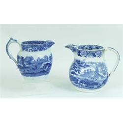 AN OLD ENGLISH BLUE AND WHITE JUG: transfer printed flowers to the  rim and handle, a river scene