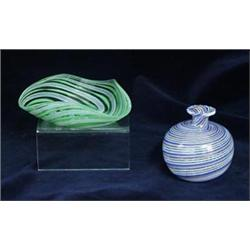 A SMALL BULBOUS VENETIAN GLASS VASE: with decoration of swirling pink,  white and blue stripes, 3
