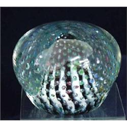A VICTORIAN PAPERWEIGHT: centred a white striped cone shape within a  multi-coloured dot surround