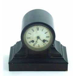 A LATE VICTORIAN MANTLE CLOCK: with eight day movement striking to  bell and white enamel dial wi