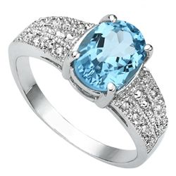 FINE 7X9MM OVAL BLUE TOPAZ & DIAMOND ACCENT RING