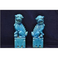 Pair of Foo lions resting their paw upon a ball 14