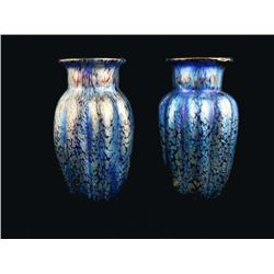 Pair of art glass blue Loetz vases.