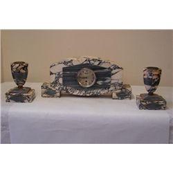 Art Deco Clock and matching pair of Garnitures