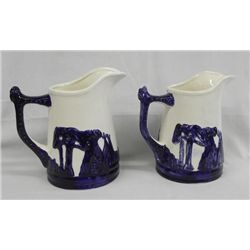 Reproduction Pair ''Old Sleepy Eye'' Blue Pitchers