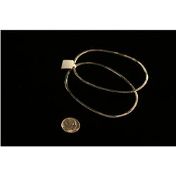 Pair of Sterling Oval Bangles,