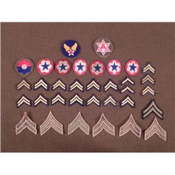 COLLECTION OF 34 UNIT PATCHES AND CHEVRONS