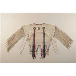 Ladies yoke or cape to be worn over dress showing fancy beadwork on tanned hide with long fringe and