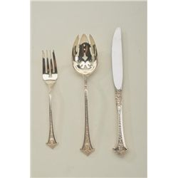 39 pieces of Sterling silver flatware plate settings and extra serving pieces. Fancy pattern in exce