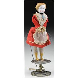 GERMAN TOP TOY WITH DANCING DOLL.