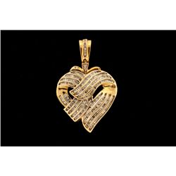 (1) 14ky heart shaped pendant set with round and baguette diamonds est. 1.25 cttw, 18 grams