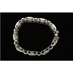 "BRACELET: Gents 14kw ""invisible"" set irradiated blue, yellow, & white diamond link bracelet; 96 sq p"