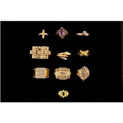(1) 10ky butterfly ring, size 7; 1.3 grams  (1) 14ky cross ring, size 3 3/4; 1.2 grams  (1)  10kt Tr
