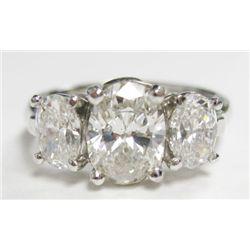 Designer Signed Platinum Setting w/ GIA Certified Oval Cut Diamonds - Center oval brilliant - GIA# 2