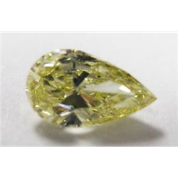 GIA Certified 1.03 carat Pear Modified Brilliant. Natural Fancy Yellow Color/VVS2 Clarity. Medium Bl