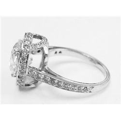 GIA Certified 3.02 carats Cushion Brilliant Diamond set in Platinum Basket Setting w Round Pave Diam