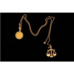 (1) 10ky chain necklace with 10kt scale pendant and 14kt coin pendant, 13.6 grams
