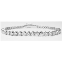 18k White Gold Tennis Bracelet w/ Round Brilliant Cut Diamonds, TAW: 4.8 carats. 48 round brilliant
