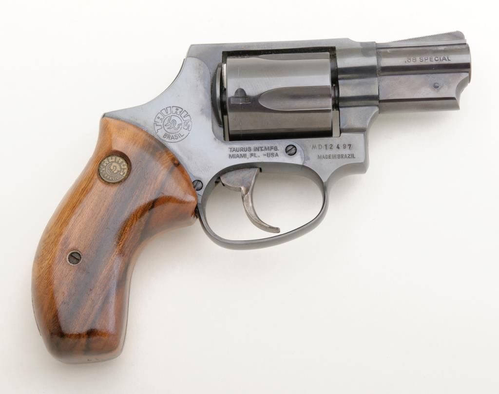 "Taurus DA revolver,  38 Special cal , 2"" barrel, blue finish, bobbed  hammer, smooth wood medallion g"