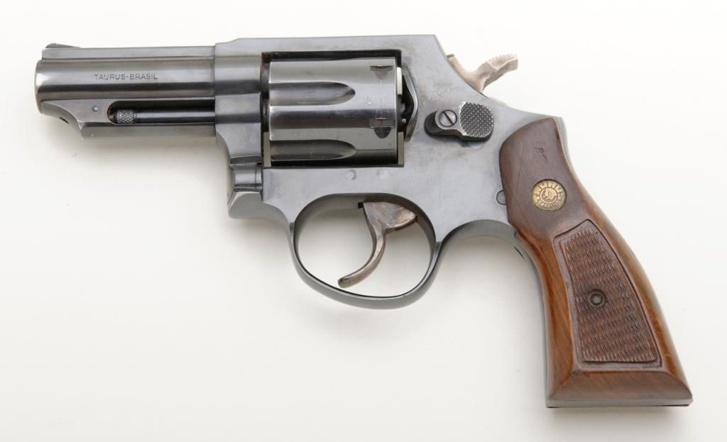 "Taurus DA revolver,  357 Magnum cal , 3"" barrel, blue finish, checkered  wood medallion grips, #LB582"