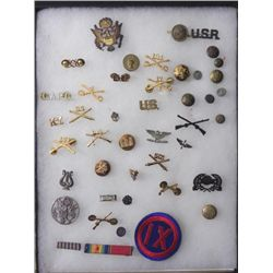 LOT OF US MILITARY INSIGNIA, PATCHES ETC-IN RIKER MOUNT