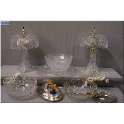 A pair of pinwheel crystal bedside lamps, pressed  glass and crystal dishes, and a selection of  sil